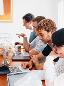 digital designers at desk using computers