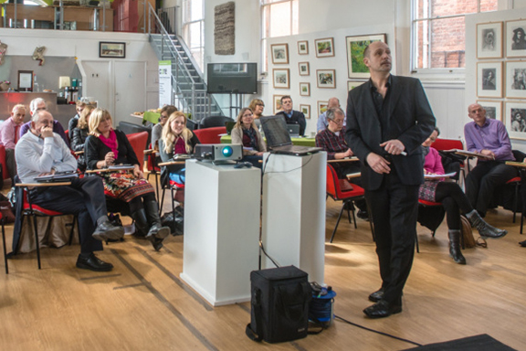 director andrew knutt delivering a business workshop in an arts centre